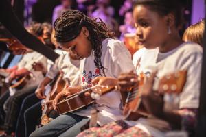Students holding ukuleles