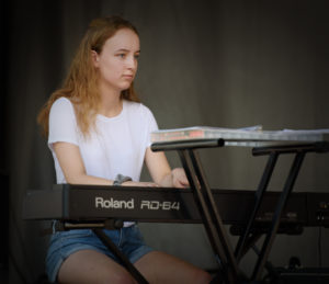 Girl playing piano onstage